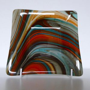 Fused glass dish and orange-turquoise swirls