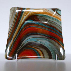 Fused glass dish and orange-turquoise swirls